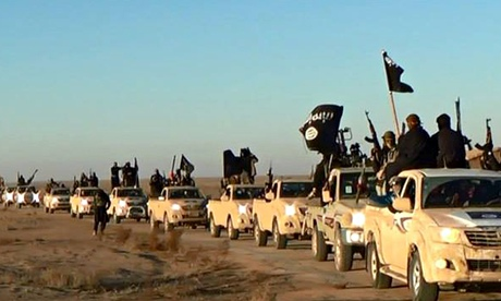 Isis fighters, pictured on a militant website verified by AP. Photograph: AP